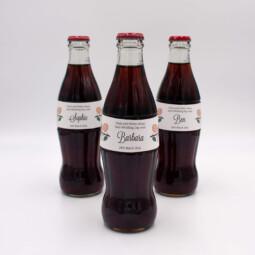 Ellie and Liv coke bottle wedding favour